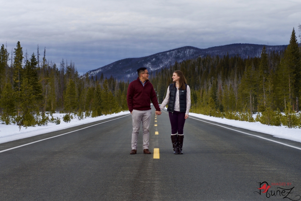 Katie and Eddy Holding Hands on Road