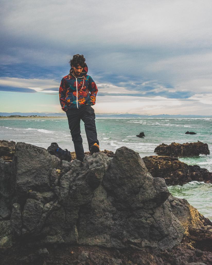 Oren Standing on Rocks